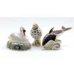 Royal Crown Derby 'Swan' and 'Dolphin' paperweights, both with silver stoppers and 'Song Thrush' paperweight, with gold stopper