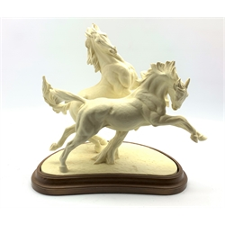 Royal Worcester group 'Galloping Horses' by Doris Lindner No. 3466 in a wooden stand H41cm x W43cm