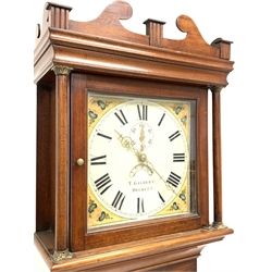 Early 19th century mahogany long case clock, swan neck pediment, plain pilasters and trunk door, raised on shaped bracket feet, the white painted enamel dial decorated with painted floral spandrels, with Roman numeral chapter ring, subsidiary seconds ring and date aperture, signed 'T. Gilbert, Beckley,'  having a 30 hour single weight driven movement, H201cm (MAO1902)