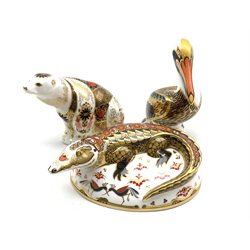 Royal Crown Derby 'Crocodile', 'Brown Pelican' and Imari 'Polar Bear' paperweights, all with silver stoppers