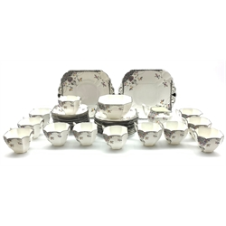 Shelley  'Black Leafy Tree' pattern tea service, pattern no. 11575, Queen Anne shape, comprising twelve cups and saucers, twelve plates, milk jug, sugar bowl and two bread and butter plates (40)