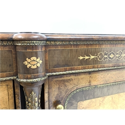 Victorian bur walnut credenza, well figured top above gilt metal mounts and marquetry inlaid frieze, panelled cross banded door with further boxwood inlay enclosing two shelves, flanked by two bow fronted glazed doors, raised on compressed bun feet, W166cm, H113cm, D45cm