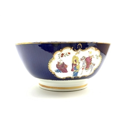 19th Century English porcelain punch bowl painted with panels of Chinese figures on a dark blue ground, with further figures to the interior on a gilt lined foot c1840 D31cm