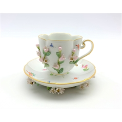 Meissen cabinet cup and saucer of lobed oval design decorated with applied and painted flowers and insects
