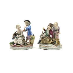 Pair of Thuringian porcelain figure groups depicting Summer and Winter  on oval bases approx 15cm x 13xm