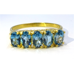 Silver-gilt five stone blue topaz ring, stamped Sil
