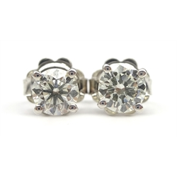 Pair of 18ct white gold, round brilliant cut diamond stud earrings, stamped 750, diamond total weight 0.80 carat