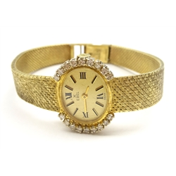 Ebel 9ct gold ladies manual wind wristwatch, the bezel set with nine diamonds on each side, London 1968