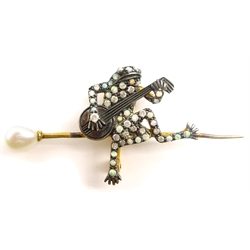 Diamond, pearl and opal brooch of a frog playing a banjo