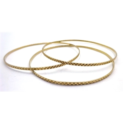 Three 9ct gold bangles hallmarked, approx 8.1gm