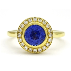 18ct gold round sapphire and brilliant cut diamond halo cluster ring, stamped 750, sapphire approx 1.30 carat