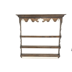 18th century oak dresser, with wall mounted three hight plate rack, two frieze drawers enclosed by applied turned split pilasters, raised on turned block supports united by pot tray, W142cm