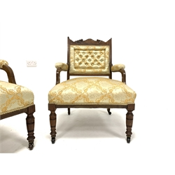 Edwardian rosewood four piece drawing room suit, comprising of a three seat sofa, carved cresting rail with scrolled floral boxwood inlay, deep buttoned back panel, open arms, upholstered in floral embroidered yellow and ivory silk, raised on turned supports terminating in castors, (W130cm) a similar open arm chair, (W57cm) and a pair of side chairs, (W46cm)