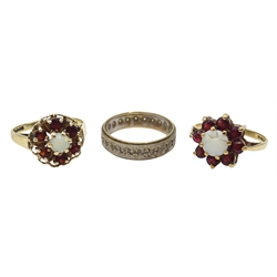 Two 14ct white and yellow gold hoop earrings, single 14ct gold stone set earring earring, all stamped 585, two gold garnet and opal cluster rings and one other gold ring, all hallmarked 9ct