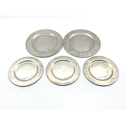 Pair of sterling silver plates marked 'L.M.' D18cm and three matching smaller plates D14cm 25.7oz