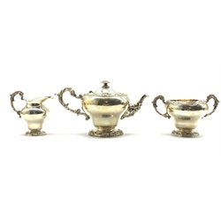 Late Victorian silver 3 piece circular tea set with embossed floral decoration, London 1897 Makers Wakely and Wheeler 50.8oz