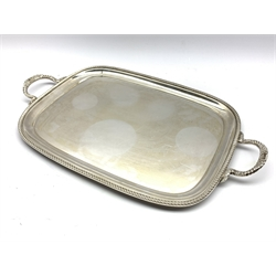 Silver rectangular two handled tray with gadrooned edge and floral handles 57cm x 34cm overall, Sheffield 1971 Maker E H Parkin & Co 59.3oz