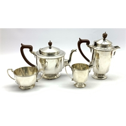 Silver circular four piece tea set, of panel sided design, Birmingham 1928, makers Mappin & Webb 55.17oz gross