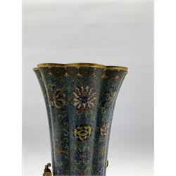 Chinese cloisonne vase, 18th Century, of lobed circular form decorated with an all over floral design on a turquoise ground beneath a flared rim and with gilt bronze key pattern supports and gilded interior H30cm, adapted for use as a table lamp and on a later marble base   Provenance: Property of a Lady of Title