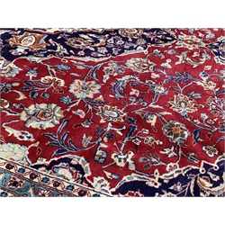 Persian Meshed ground carpet, floral medallion on red field surrounded by foliate, triple guarded border, 278cm x 390cm