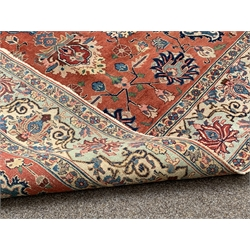 Persian design Hamadah ground rug, floral medallion on red field, trailing stylised foliate to border, 238cm x 309cm