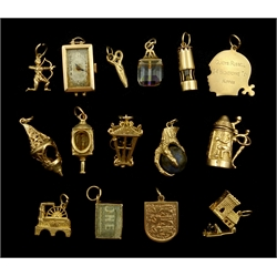 9ct gold charms including lapis lazuli eagle claw, lanturns and tankard and a 9ct gold ladies wristwatch, all hallmarked, stamped or tested