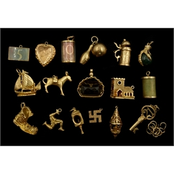 9ct gold charms including boat, boot, blood stone eagle claw and church, 18ct gold donkey charm, all hallmarked, stamped or tested and one other gold-plated heart charm