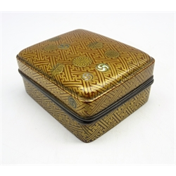 Japanese rectangular lacquer box and cover Edo period (18th-19th Century)decorated in gold hiramaki and mother of pearl inlays on a red ground with geometric design and various mon, the interior with a boat in stormy seas in gold and black and with pewter rims 8 x 7 cms-  Soame Jenyns Collection