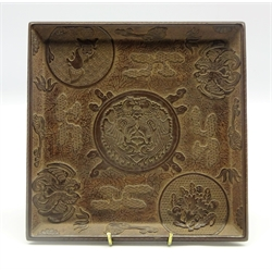 Chinese 19th Century lacquer tray carved in relief with a central cartouche of two Phoenix on a brown ground with further birds, a Buddhist lion etc 18 cms sq.-  Soame Jenyns Collection
