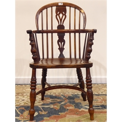 19th century yew wood low stick and pierced splat back Windsor armchair, turned supports with crinoline stretcher, W55cm