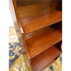 20th century mahogany four tier narrow open waterfall bookcase, turned supports with castors, W51cm, H126cm, D31cm