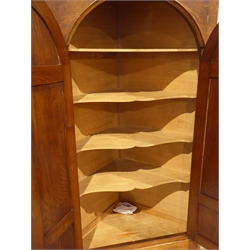 'Acornman' oak corner cabinet on stand, two arched fielded panelled doors enclosing four shaped shelves, by Acorn Industries, Alan Grainger, Brandsby, York, W90cm, H179cm