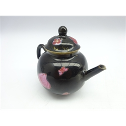 Small famille rose Quianlong globular teapot with leaves and flower heads on a black ground H8.5cms.Provenance:  Hancock, London