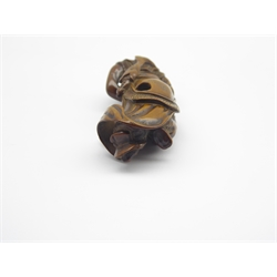 Japanese carved wood netsuke, Edo period (Late 18th-Early 19th Century) carved as a Ran Ryo-o dancer in elaborate robes, his headdress surmounted by a dragon, a fish over his back H 8cms-  Soame Jenyns Collection