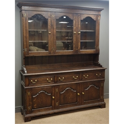 Traditional oak dresser, projecting cornice, three stepped arched glazed doors enclosing three shelves, above three drawers and panelled cupboard doors, bracket feet, W169cm, H203cm, D46cm