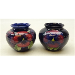 Two Moorcroft Pansy pattern baluster vases on blue ground, H7cm (2)