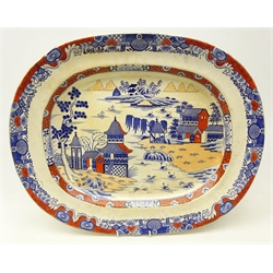 19th century Masons Ironstone china meat plate decorated with pagodas within a river landscape, with underglaze blue and iron red painted decoration, L49cm