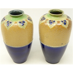 Pair Royal Doulton stoneware vases of baluster form with half glazed body and chine ware decoration below tube lined leafage, possibly by W. Baron, H24cm