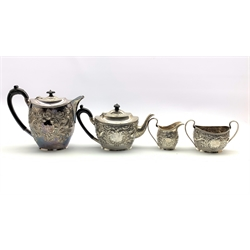 Late Victorian silver four piece tea set of oval form embossed with birds and flowers around a cartouche engraved with the initial 'A', the teapot and hot water jug with ebonised handles and lifts Birmingham 1897 Maker Z Barraclough & Sons 50oz gross