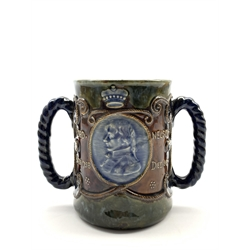 Royal Doulton 'Lord Nelson' loving cup with rope work handles decorated with a portrait bust of Nelson with script to the reverse in blue, brown and green H15cm