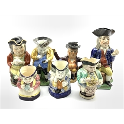 19th Century Staffordshire figural teapot H20cm, a snuff taking Toby jug and five other similar pieces (7)