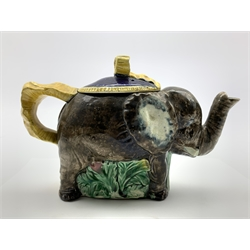 Majolica elephant tea pot, the basket weave blue lid with a yellow tied ribbon finial and handle L22cm x H13cm