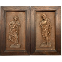 Antonio de las Penas y Leon (Spanish 1815-1886) Pair of terracotta plaques of a male figure wearing a cloak and a female figure in a lace edged dress, each 28cm x 15cm, signed.