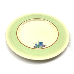 Clarice Cliff plate decorated with the crocus pattern within a pale green border D25cm
