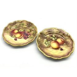 Pair of Royal Worcester cabinet plates painted with panels of fruit by R Price and S Weston with a gilded edge D20cm