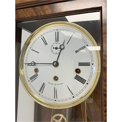 Inlaid mahogany cased wall clock, white enamel dial with Roman numeral chapter ring and subsidiary seconds dial, signed Comitti of London, the eight hour Westminster chime movement striking on the quarters, with silent function, H105cm