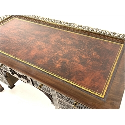 Early 20th century mahogany knee hole writing table, the half galleried top inset with tooled leather writing surface, over one long drawer with carved applied acanthus leaf decoration, flanked by two banks of three graduating drawer with blind fret work faces, raised on cabriole supports with ball and claw feet, W123cm, H79cm, D60cm