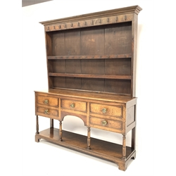 George III oak dresser, three heights plate rack fitted with cast iron hooks over five drawers, raised on turned supports with pot board base, W162cm, D39cm