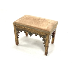 Early Victorian stool of Gothic design, with upholstered seat and gilt painted decoration, raised on square tapered supports, W56cm, H42cm, D36cm