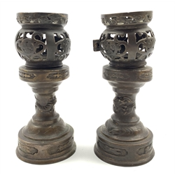 Pair of late 19th/20th Century Chinese bronze censers with pierced decoration on pedestal stands and circular foot H16cm
